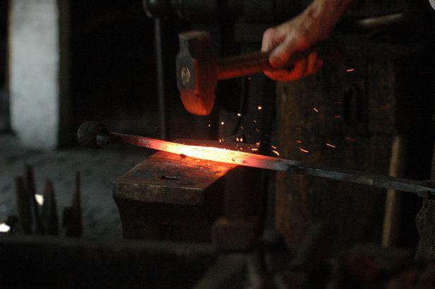 800px-Blacksmith_working